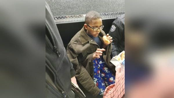 A photo showing Sincere just moments after being rescued. He enjoyed a donut in the safety of police custody.