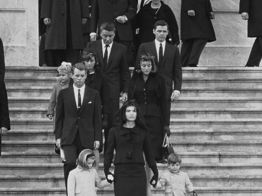 Kennedy family members descend steps in Washington, Nov. 25, 1963, at the funeral for President John F. Kennedy.  From front to back at left are: Caroline Kennedy, Jacqueline Kennedy and John Kennedy Jr.; behind them, Robert F. Kennedy, Patricia Kennedy Lawford and her husband, Peter Lawford; Little Sydney Lawford is at left of her mother. Behind Mrs. Kennedy are Jean Kennedy Smith and her husband Stephen E. Smith.  Near top are President Lyndon B. Johnson and his wife Lady Bird Johnson. (AP Photo)