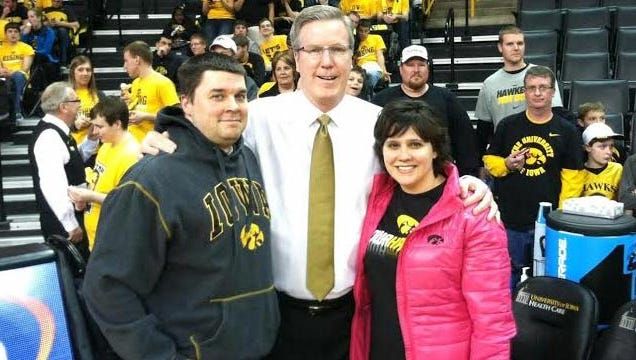 Iowa coach Fran McCaffery (middle) stands with Matt and Melissa Starmer before a recent Hawkeyes game in Iowa City.