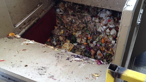 Restaurant food waste at QRS facility in Louisville gets compacted in a container that's sealed and taken to a composting facility in southern Indiana.