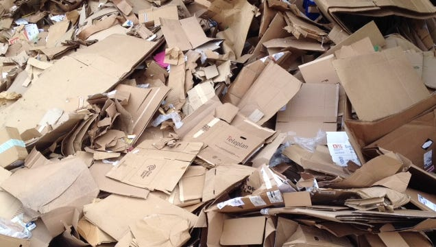 File photo of cardboard to be prepared for shipment for recycling at the QRS facility in Louisville.