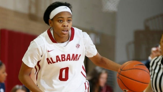 Former Alabama point guard Daisha Simmons' high school coach, Mergin Sina, had his boys basketball team participate in the torando relief efforts in Tuscaloosa in 2011.