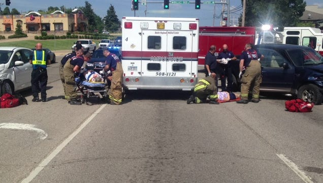 Emergency personnel from Baxter Regional Medical Center and Mountain Home Fire Department treat two female drivers injured in an accident at the intersection of Wallace Knob Road and U.S. Highway 62 on Tuesday afternoon.
