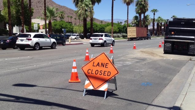 Southern California Edison contractors work Tuesday, Aug. 5, 2014, at the intersection of Indian Canyon Drive and Ramon Road in Palm Springs.