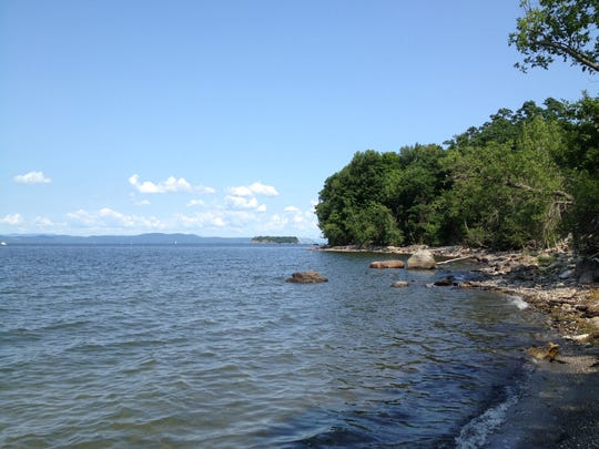 Paddlers who make their way around Shelburne Point find themselves in broader waters facing the Adirondacks.