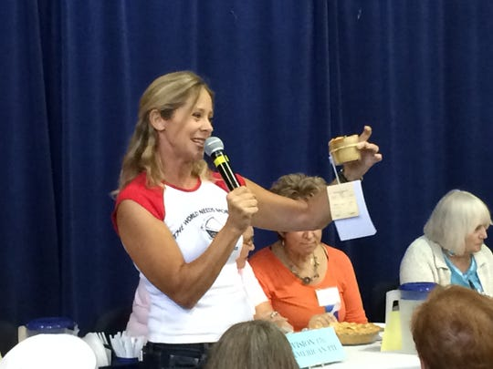 Cookbook author Beth Howard holds up one of Sharyn Jackson and Laryssa Husiak's pies in a jar at the Ms. American Pie contest at the Iowa State Fair on August 13, 2014.