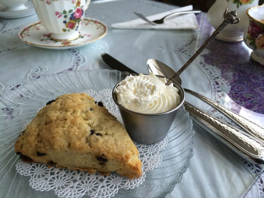A handmade blueberry scone with Devonshire cream from Wisteria Tea Room in Fort Myers.