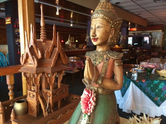 Thai sculptures greet guests at Siam Hut, the area's