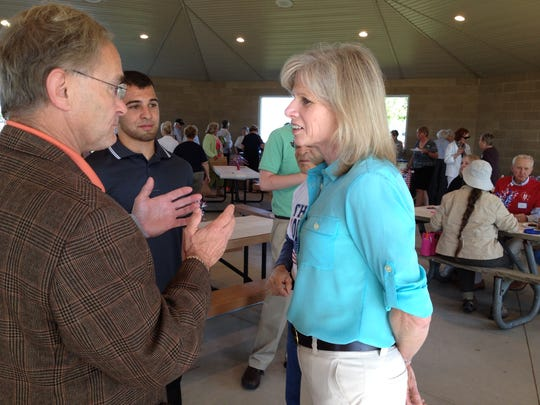 Mary Burke, Democratic candidate for Wisconsin governor, talks with Peter Barca, Wisconsin Assembly minority leader, at a Democratic Party picnic in Sturgeon Bay Thursday evening.