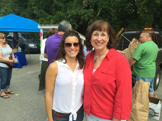 Shannon Bush, a city and regional planning masters student at Cornell, stands with Mayor of Amsterdam Ann Thane at the Amsterdam Farmers Market on August 2. Bush is interning with the City of Amsterdam Community and Economic Development Department.