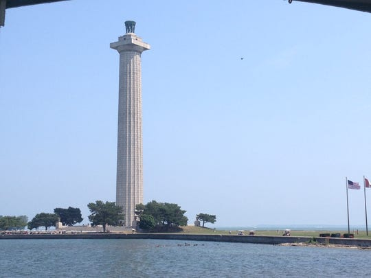 Visitors can be spotted atop Perry's Victory and International Peace Memorial on Sunday, Aug. 10, 2014, at Put-in-Bay.