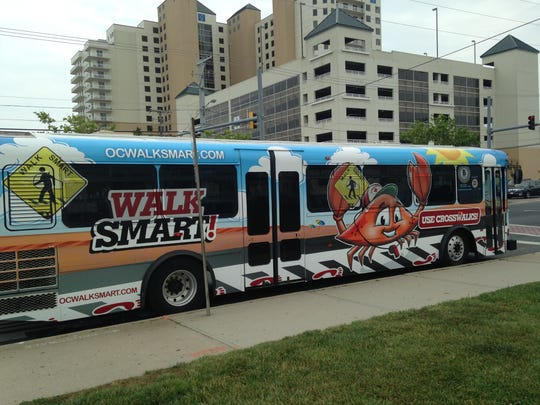 The OC Walk Smart campaign, designed to promote pedestrian safety, is advertised on local buses, banners and billboards.