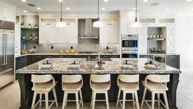 The move-in ready, 2,285 square-foot Serino Caribbean at Palazzo at Naples features a gourmet kitchen, swimming pool, and expanded garage.