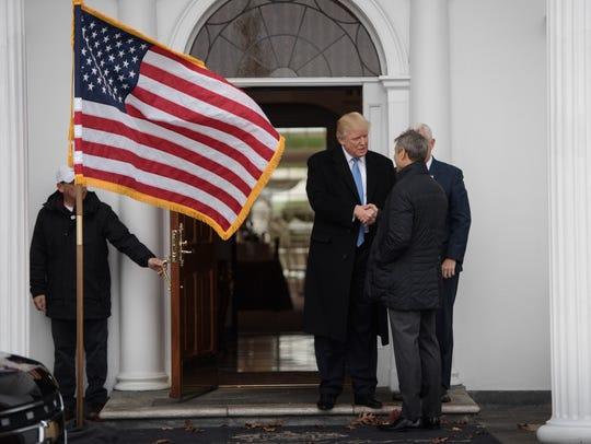 President-elect Donald Trump greets Ari Emanuel in