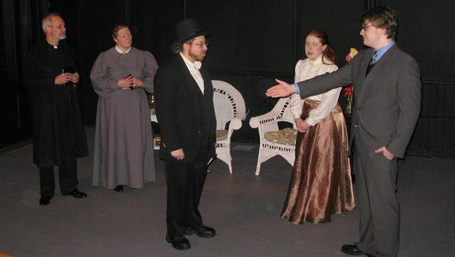 Jack Worthing is horrified to discover that his friend, Algernon, is impersonating Jack's secret identity: Ernest. That's Mis Prism (a maid) on the left and Cecily (Jack's ward) in the middle.