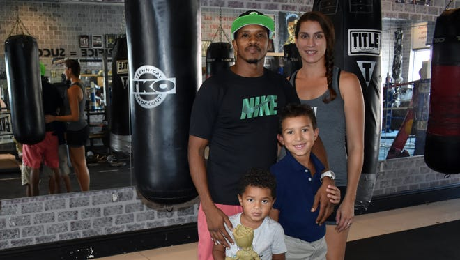 Sweet Science Training Center owners Chris & Lucina Gray with Malachi and Elijah at their gym located 1137 21st Street in Vero Beach.