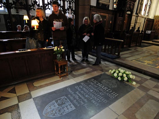 The Richard III memorial stone gets some extra attention at Leicester Cathedral, England, on Monday, the day scientists confirmed a skeleton found beneath a city parking lot belongs to the long-lost monarch.