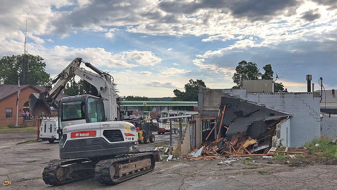 The building that recently housed  Decker's Depot Party Shoppe in Lexington was demolished Tuesday morning.