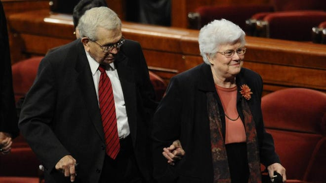 President Boyd K. Packer leaves the October 2010 general conference with his wife, Donna.