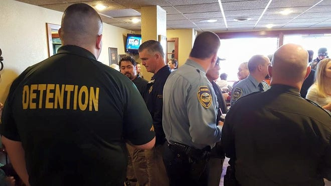 """Various law enforcement officers including Cascade County Sheriff Bob Edwards visit with community members at the """"Coffee with a Cop"""" event at Schulte's Coffeehouse Wednesday. A woman was arrested for DUI toward the end of the event."""