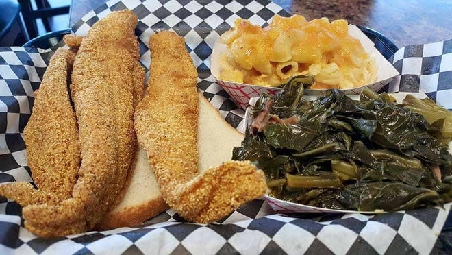 The Rolling Rooster serves fried chicken and fish, along with soul food plates that include oxtails, collard greens and more.