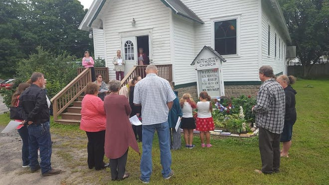 Parishioners at Lowell United Methodist Church gather for a church services pre-COVID-19 restrictions.