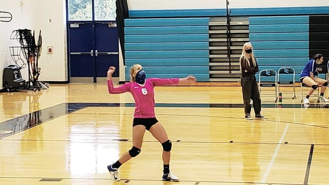 Olivia Banton serves an ace against Lincoln County Thursday night. She served 21/21 with 8 aces.