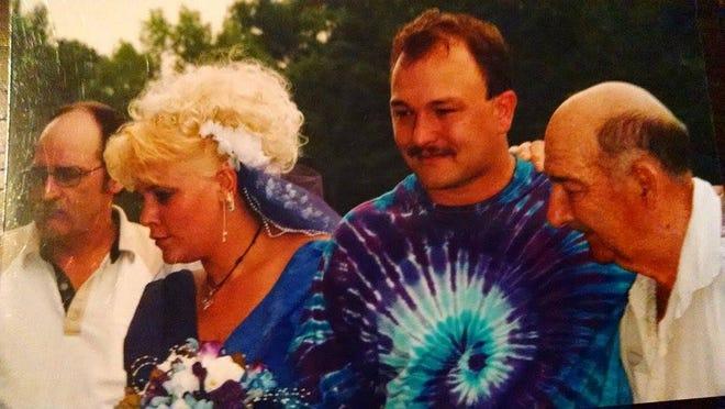 Jan and Chris Harrington, center, on their wedding day, Aug. 16, 2003.