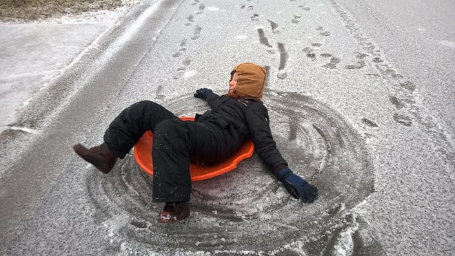 Although there wasn't a nearby hill to sled down, Ethan Parker had fun spinning his snow disc in a circle.