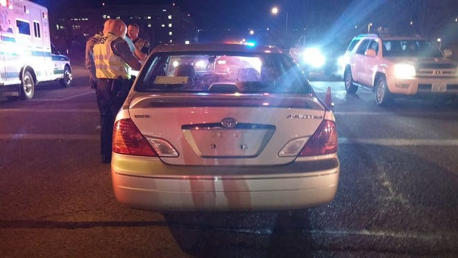 Police investigate the scene of a crash on River Road and 700 South Wednesday evening.
