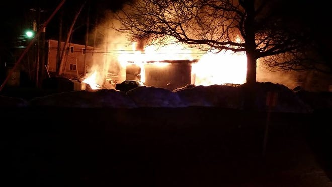 Flames erupt from the Hillcrest Service Center, 311 N. Main St. in Hillcrest, March 19, 2015. The building was engulfed by flames when firefighters arrived. The fire caused heavy damage.