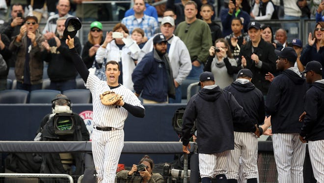 Yankees first baseman Mark Teixeira waves to fans after he is pulled from the field in his final Major League game, against the Baltimore Orioles at Yankee Stadium.
