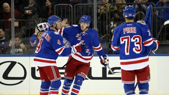 New York Rangers left wing Pavel Buchnevich (89) celebrates with defenseman Adam Clendening (4)  after his goal against the Winnipeg Jets during the second period at Madison Square Garden.