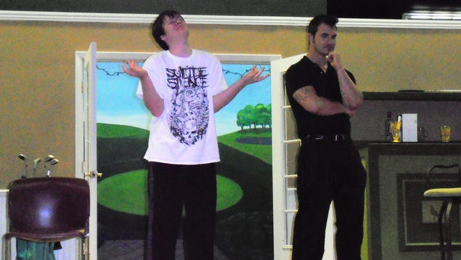 Justin Hicks (Zack Miller) tries yoga to calm his nerves before the tournament, with a skeptical Henry Bingham (Michael Hillis) looking on.