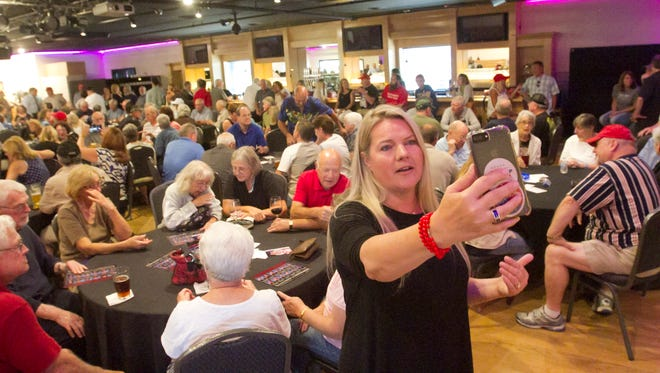 Meshawn Maddock, co-founder of Michigan Trump Republicans, live streams the activity at Block Brewing in Howell Tuesday, Aug. 15, 2017. The event was held to support President Donald Trump.