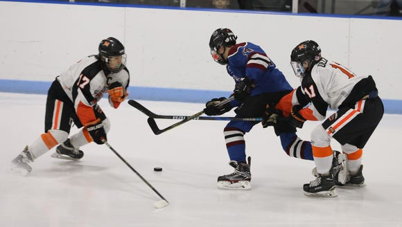 Rye Town/Harrison's Jack Shapiro moves the puck in