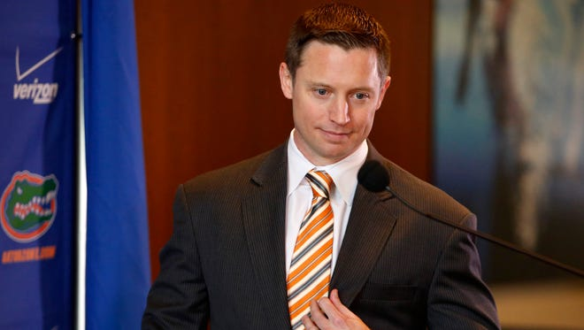 New Florida basketball coach Mike White prepares to speak at his introductory press conference in Gainesville, Florida, on Monday. White was hired to replace Billy Donovan, who left for the NBA's Oklahoma City Thunder after 19 years with the Gators.