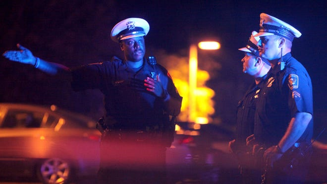 Cincinnati police investigate the scene of a double shooting near the corner of Wardall and Epworth avenues in Westwood late Thursday night.