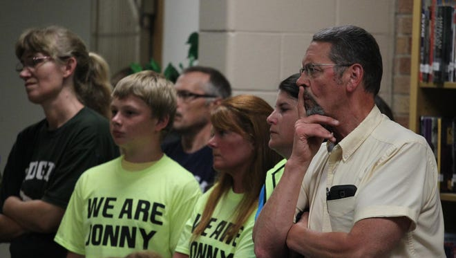 The crowd listens to a speaker at the Edgar School Board meeting as the bullying-related suicide of Jonathan Wesener and its aftermath are discussed on Monday, June 29.