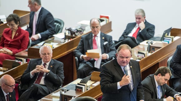 Rep. Chuck McGrady, R-Henderson, standing, speaks during a House session earlier this year.