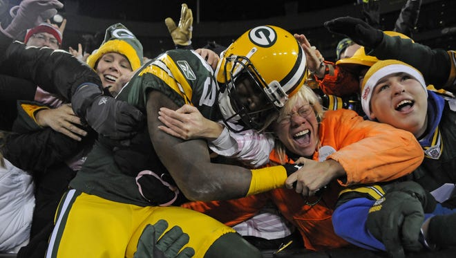Green Bay Packers receiver James Jones celebrates his touchdown with a Lambeau Leap during against the Chicago Bears at Lambeau Field on Dec. 25, 2011.