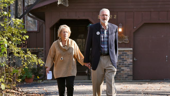 """Patty and Jerry Wetterling walk down their driveway to speak to reporters Tuesday at their home in St. Joseph to address the arrest of a """"person of interest"""" in the abduction of their son, Jacob. The Wetterlings said they were surprised when authorities told them they had identified a person of interest in their son Jacob's abduction 26 years ago."""