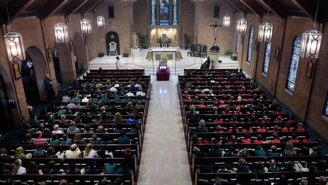 Students from local Catholic schools fill the pews while others stand in the annex on Nov. 2, 2015 at The Cathedral of the Immaculate Conception in Tyler, Texas.