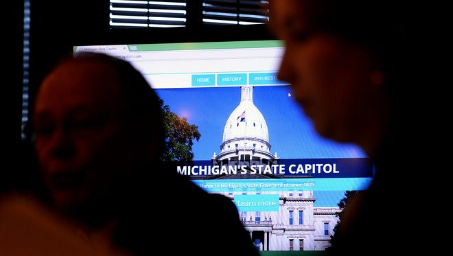 Members of the Michigan State Capitol Commission sit around a table during their meeting Monday, November 9, 2015, where a new virtual tour of the Capitol building was showcased for the first time. The virtual tour, which includes a 3-D tour, videos, interactive information and more is available at www.mistatecapitol.com