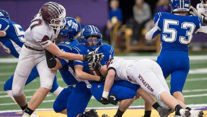 Van Meter running back Carson Rhodes (7) is taken down by Western Christian Hull line backer Jacob Uittenbogaard (57) in the fourth quarter at the UNI Dome in Cedar Falls Saturday, November 14, 2015. Bill Adams/Freelance