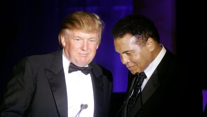 FILE - In this March 24, 2007, Donald Trump, left, accepts his Muhammad Ali award from Ali in 2007 at Muhammad Ali's Celebrity Fight Night XIII in Phoenix, Ariz. Ali is criticizing Republican presidential front-runner Trump's proposal to ban Muslims from entering the United States.