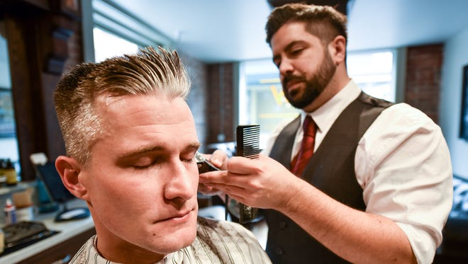 Don Duncan gets his hair cut by Vinnie Gravallese, co-owner of Derby Supply Company. Derby Supply Company is a new main's hair cutting shop designed to feel like a 1920s barber.