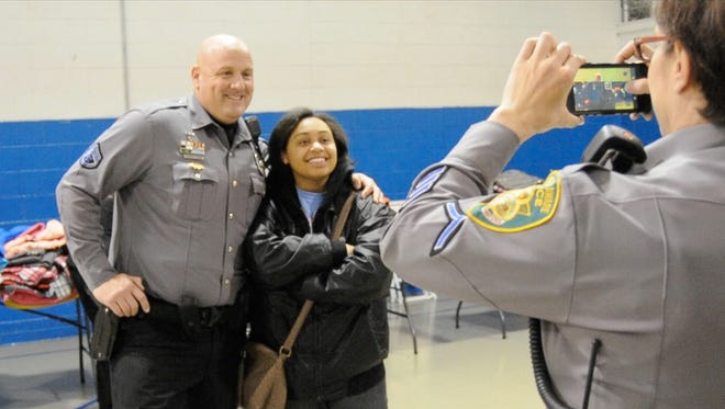 Master Cpl. Jeff Davis with the City of Dover Police Department poses for a photo with Margaret Hicks of Dover at the Boys and Girls Club in Dover.
