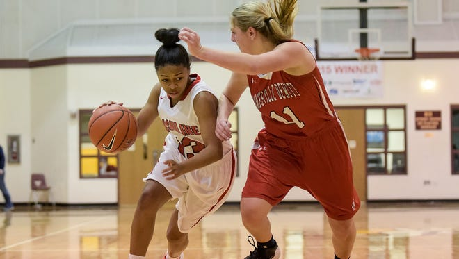 Sabriya Harris (13) of Ursuline Academy charges past Carly O'Hern (11) of Jamesville Dewitt High School (N.Y.) during the Diamond State Classic.