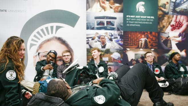 Members of the Spartan Marching Band  wait to go through security at the Capital Region International Airport this morning.  The band and some members of the MSU Dance Team left Tuesday morning for The Cotton Bowl in Dallas.